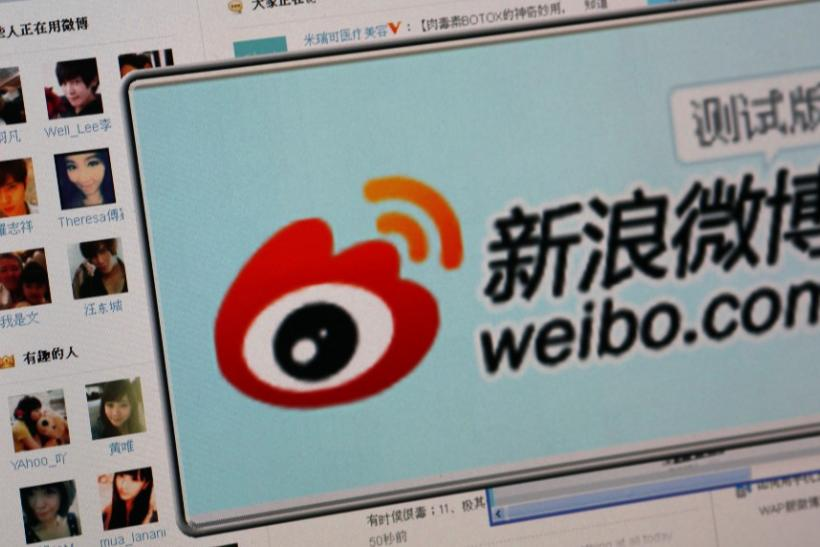 """The logo of Sina Corp's Chinese microblog Web site """"Weibo"""" is seen on a screen in this photo illustration taken in Beijing"""