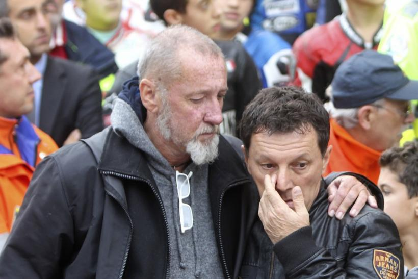 Honda Gresini MotoGP team manager Fausto Gresini reacts at the end of the funeral service of MotoGP rider Marco Simoncelli in Coriano