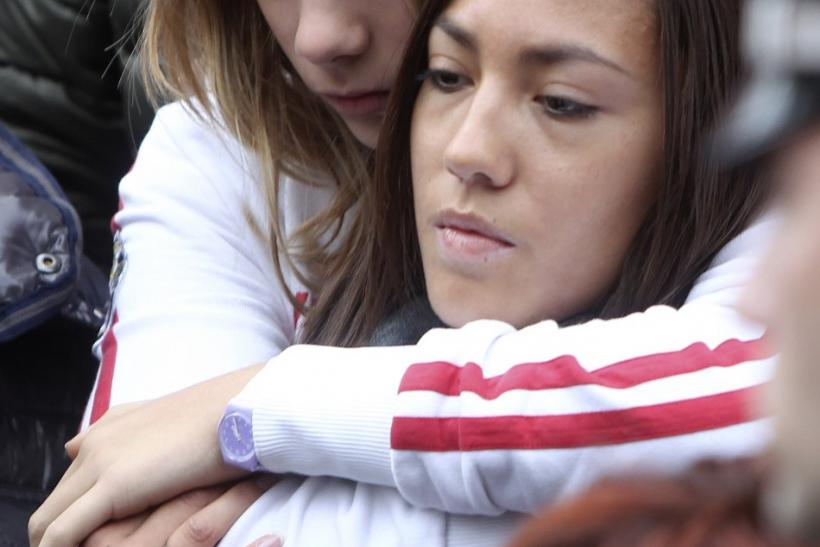 Honda MotoGP rider Marco Simoncelli's sister Martina and girlfriend Kate react at the end of the funeral service in Coriano