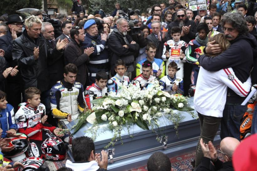 People clap at the end of the funeral service of Honda MotoGP rider Marco Simoncelli in Coriano