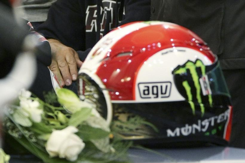 Paolo Simoncelli, the father of Marco Simoncelli, attends the funeral service of his son in Coriano