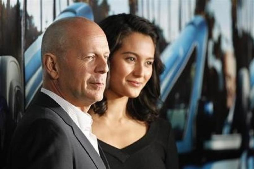 Actor Bruce Willis and his wife Emma Heming pose at the premiere of the HBO documentary ''His Way'', which portrays the life of legendary movie producer Jerry Weintraub, at the Paramount theatre in Los Angeles