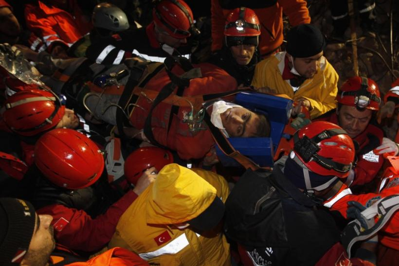 Rescue workers carry 18-year-old male survivor named Imdat from a collapsed building after surviving for more than 100 hours, in Ercis, near the eastern Turkish city of Van