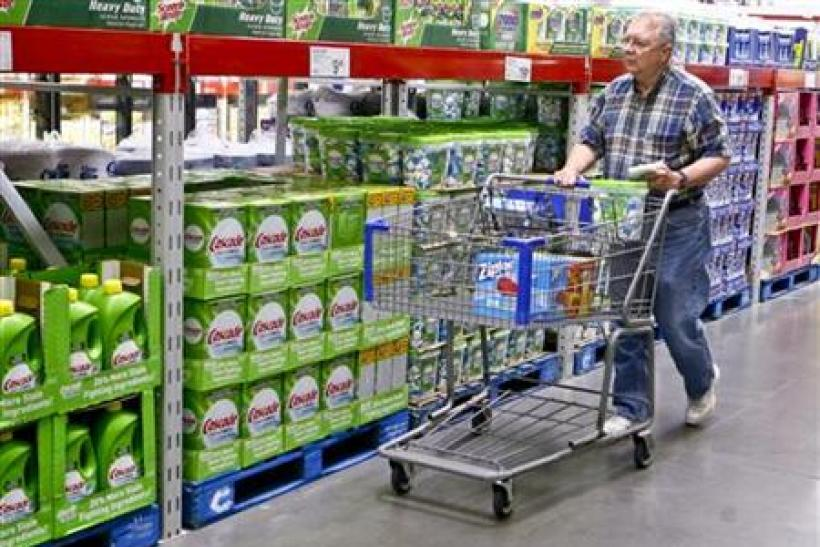A customer shops along the cleaning product aisle at a Sam's Club store in Bentonville