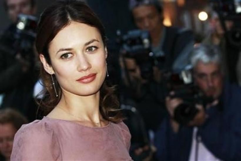 Ukrainian actress Olga Kurylenko arrives for the GQ Men of the Year 2010 Awards at the Royal Opera House in London