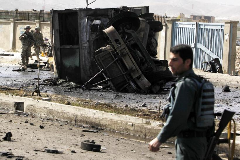 Foreign and Afghan forces arrive at the site of a suicide attack in Kabul