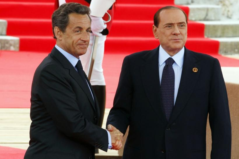 Berlusconi shakes hands with Sarkozy before the start of the G8 Summit in Deauville