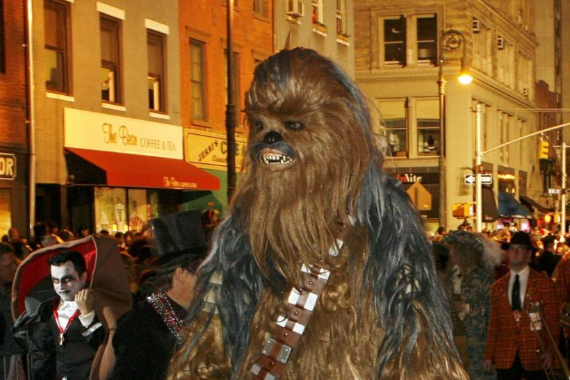 "A participant dressed as Chewbacca from the film ""Star Wars"" takes part in the annual Greenwich Village Halloween Parade in New York"