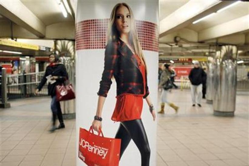 People walk past a JC Penney advertisement in a subway station in Manhattan New York