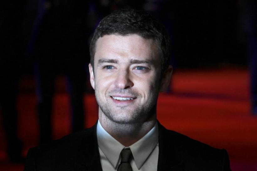 "Justin Timberlake poses for photographers at the British premiere of the film ""In Time"" at the Curzon Mayfair cinema in London October 31, 2011"