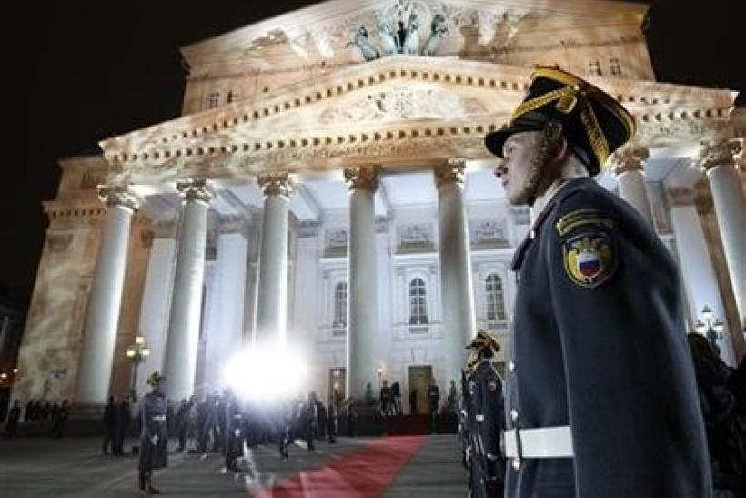 An honour guard stands in front of the Bolshoi Theater during its reopening ceremony in Moscow