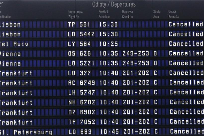A departure information board with cancelled flights is pictured in the closed Warsaw airport