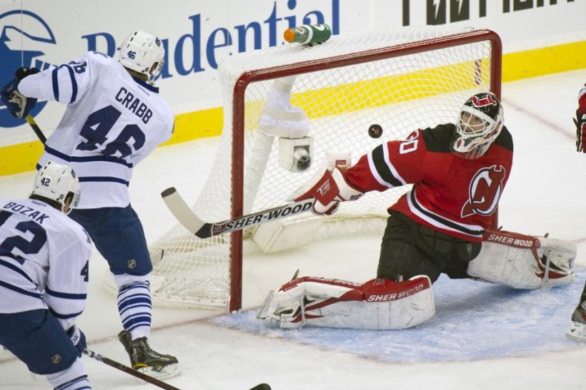Toronto Maple Leafs Joey Crabb scores against New Jersey Devils Martin Brodeur in Newark