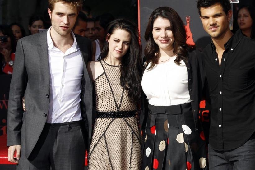 Writer Stephenie Meyer (second from right) poses with actors Robert Pattinson (left), Kristen Stewart and Taylor Lautner at their hand and footprint ceremony at the Grauman's Chinese Theatre in Hollywood, California November 3, 2011.