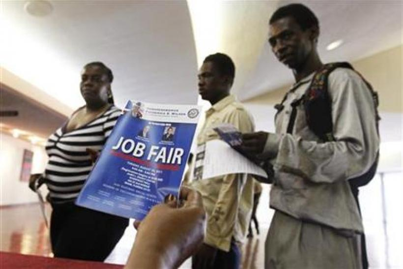 Job candidates receive information as they enter a Jobs Fair in Miami