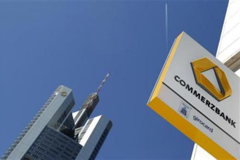 A logo of Germany's Commerzbank is seen in bright sunshine next to the headquarters of the bank in Frankfurt
