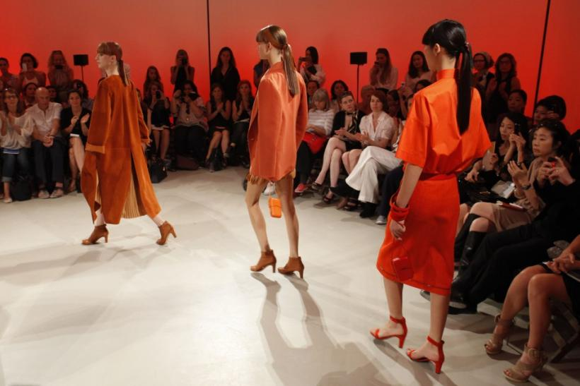 Models appear at the end of a presentation by French designer Christophe Lemaire for fashion house Hermes as part of their Spring/Summer 2012 fashion collection in Paris