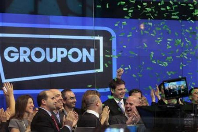 Employees and guests of Groupon ring the opening bell