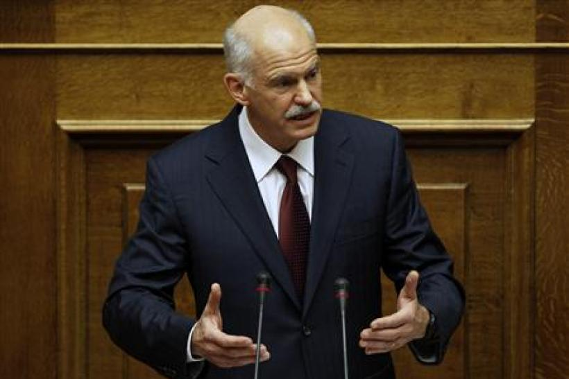 Greek Prime Minister George Papandreou addresses lawmakers in the parliament prior to a confidence vote in Athens