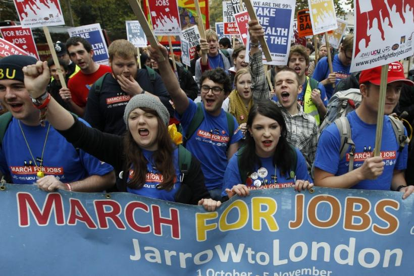 Demonstrators protest against job cuts in central London