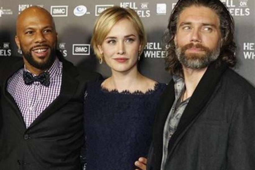 Cast members (L-R) Common, Dominique McElligott and Anson Mount pose at the premiere screening of AMC cable channel's new series ''Hell on Wheels'' in Los Angeles, California