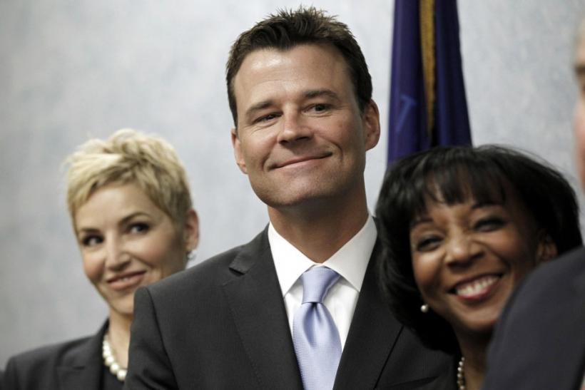 Prosecutors Walgren, Brazil and Lacey smile answers a question during a news conference in downtown Los Angeles