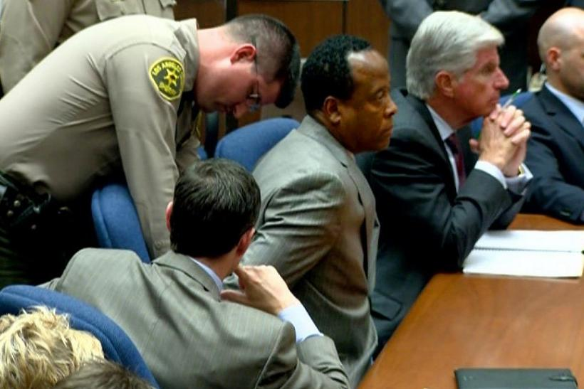 Dr. Conrad Murray is handcuffed as he is remanded into custody in Los Angeles