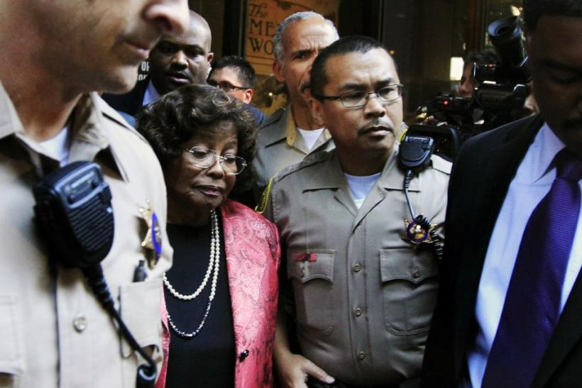 Katherine Jackson is surrounded by police officers as she leaves the courthouse after the reading of the guilty verdict in Dr. Conrad Murray's trial in Los Angeles