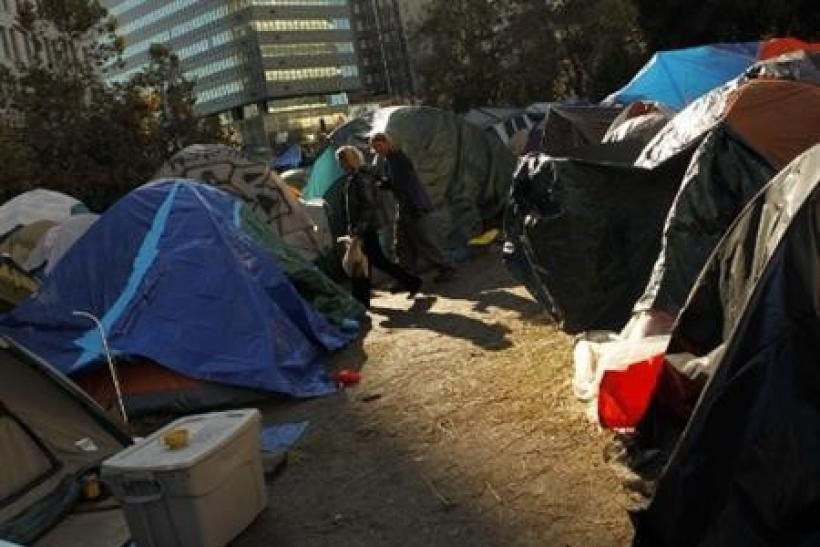 Occupy Oakland demonstrators walk through a protester encampment on Frank Ogawa Plaza in Oakland, California