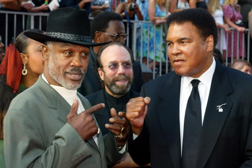 Boxers Joe Frazier (L) and Muhammad Ali pose together as they arrive at the 10th annual ESPY Awards in 2002.