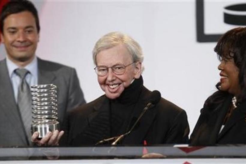 Film critic Roger Ebert accepts the Person Of The Year award with his wife, Chaz, at the Webby Awards in New York June 14, 2010.