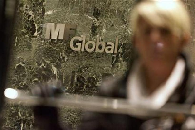 A woman leaves the office complex where MF Global Holdings Ltd have an office on 52nd Street in midtown Manhattan