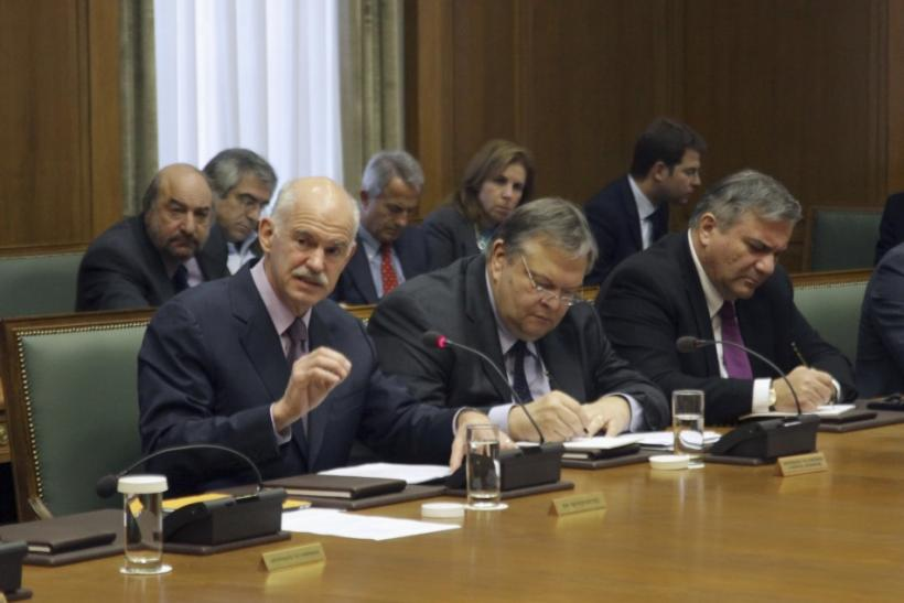 Greece's PM Papandreou leads a cabinet meeting as Finance Minister Venizelos, Interior Minister Kastanidis and Defence Minister Beglitis keep notes in Athens