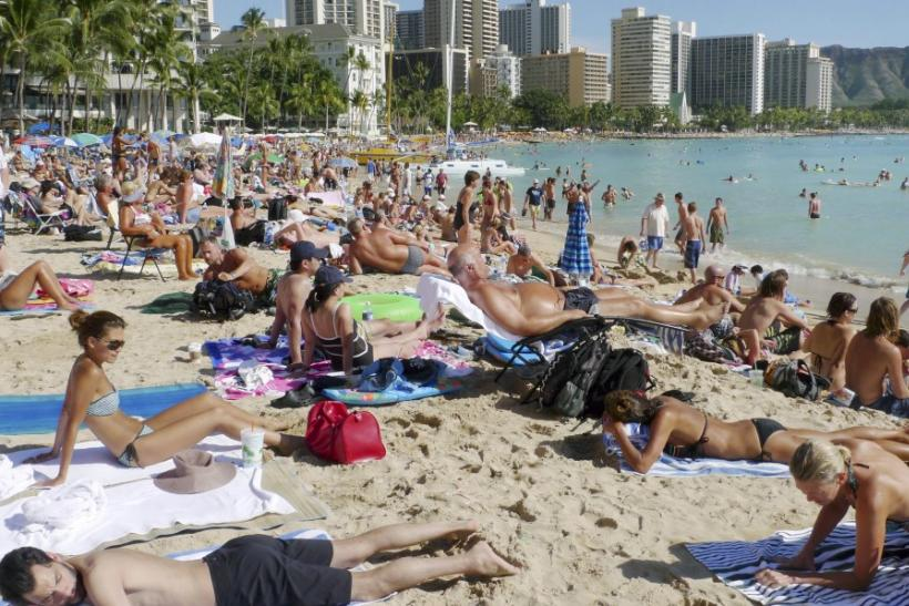 Tourists enjoy the sun on New Year's Day 2011 on Waikiki Beach in Honolulu, Hawaii.