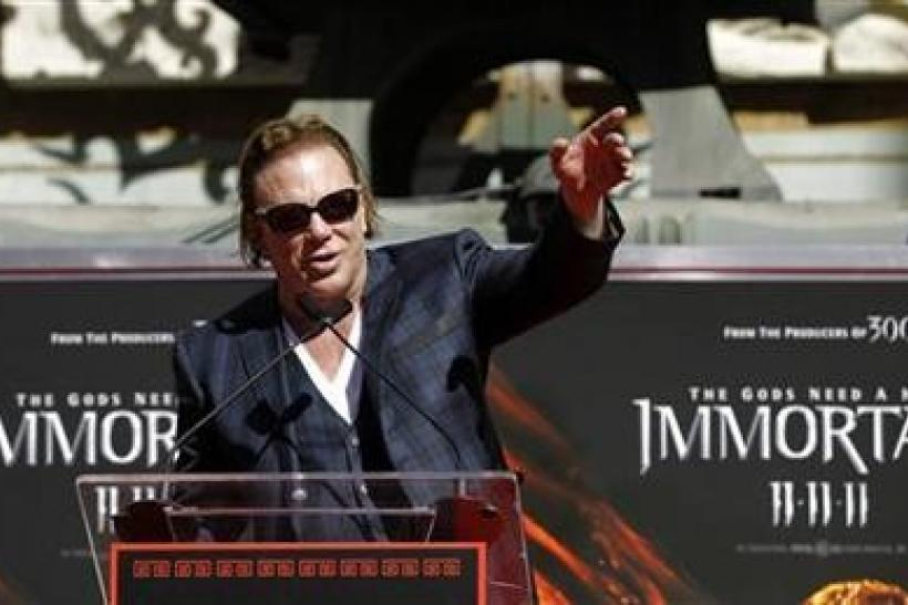 Actor Mickey Rourke speaks at his hand and footprint ceremony at the Grauman's Chinese Theatre in Hollywood, California October 31, 2011.