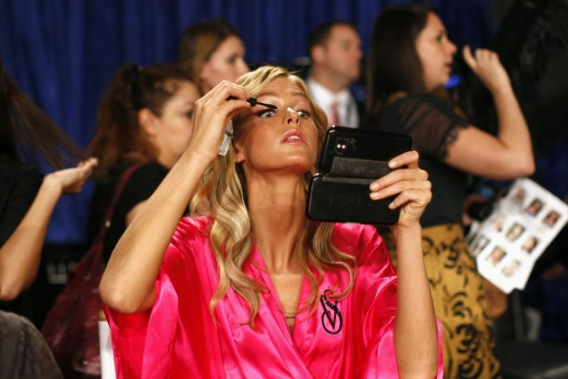 Model Model Erin Heatherton from the U.S. applies eye makeup backstage before the 2011 Victoria's Secret Fashion Show in New York