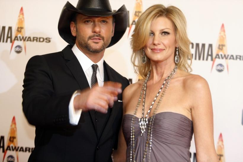 Husband and wife singers Tim McGraw and Faith Hill arrive at the 43rd annual Country Music Association Awards in Nashville