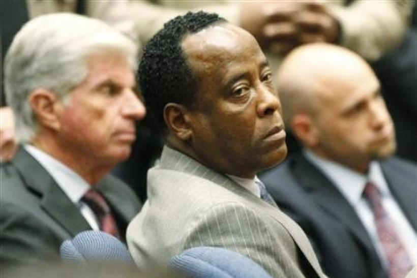 Conrad Murray next to his attorney, J. Michael Flanagan, after his guilty verdict on November 7, 2011.