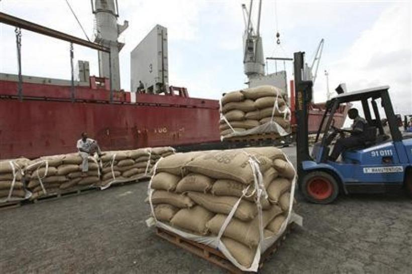 Sacks of cocoa are loaded onto a ship at the port of Abidjan