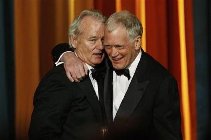 Actor Bill Murray (L) presents The Johnny Carson Award for Comedic Excellence to David Letterman (R) at ''The Comedy Awards'' in New York City