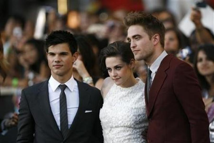 "Cast members Taylor Lautner (L), Kristen Stewart and Robert Pattinson (R) pose at the premiere of ""The Twilight Saga: Eclipse"" during the Los Angeles Film Festival at Nokia theatre at L.A. Live in Los Angeles"
