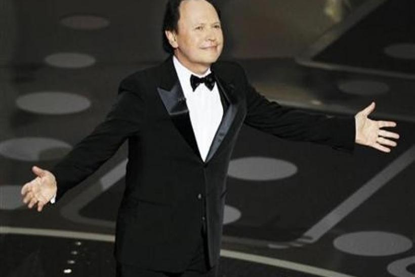 Presenter Billy Crystal stands on stage during the 83rd Academy Awards in Hollywood, California