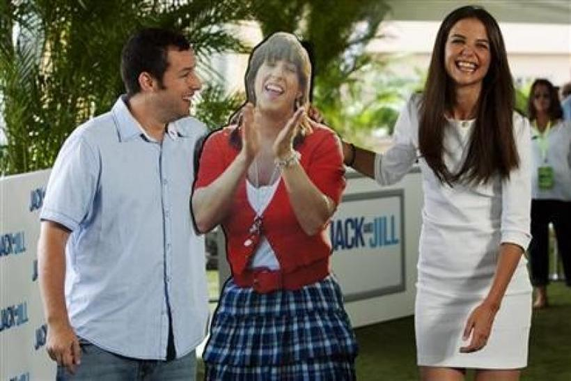 U.S. actors Adam Sandler and Katie Holmes pose with a cardboard cutout of Sandler's character during the launch of their film ''Jack and Jill'' in Cancun