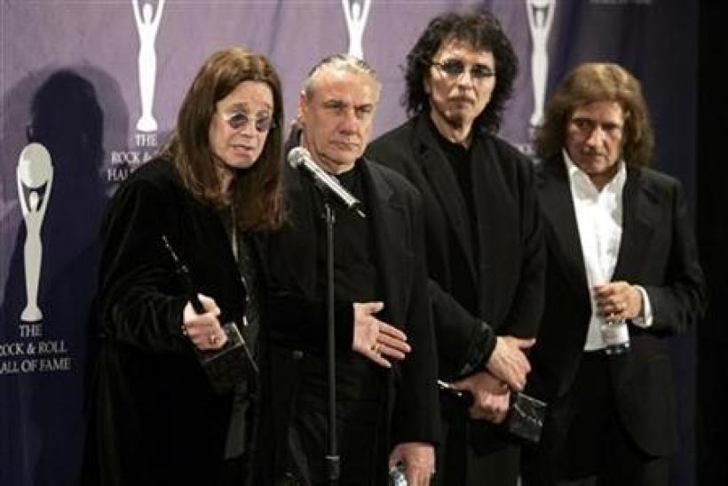 Members of Black Sabbath band Ozzy Osbourne, Bill Ward, Tony Iommi and Geezer Butler (L-R) pose backstage at the Rock and Roll Hall of Fame induction ceremony at the Waldorf Astoria Hotel in New York