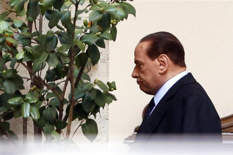 Italian Prime Minister Silvio Berlusconi leaves his residence downtown in Rome
