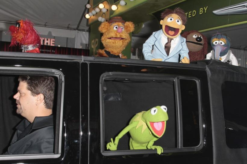 "Muppets cast members Kermit the Frog, Animal (top L), Fozzie Bear (2nd L), Walter (3rd L), Rowlf (2nd R), and Gonzo (R) arrive at the ""The Muppets"" world premiere in Hollywood, California"