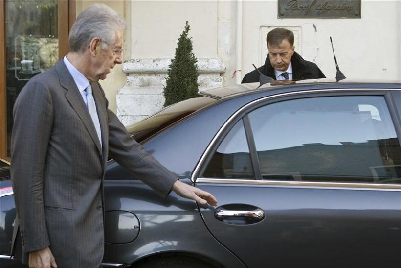 Former European Commissioner Mario Monti leaves a hotel in Rome