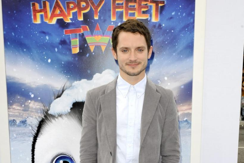 """Actor and voice of Mumble, Elijah Wood, arrives at the premiere of """"Happy Feet Two"""" in the Hollywood area of Los Angeles, California"""