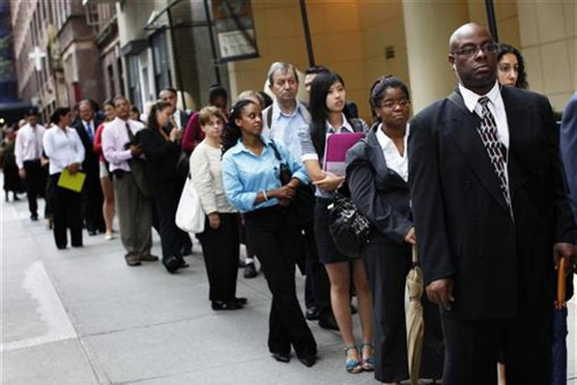 People wait in line to enter a job fair in New York August 15, 2011.