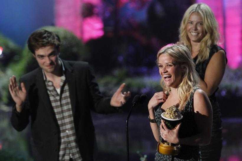 Presenters Robert Pattinson and Chelsea Handler watch Reese Witherspoon as she accepts the MTV Generation Award in Los Angeles